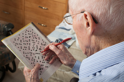 Man doing crossword puzzle