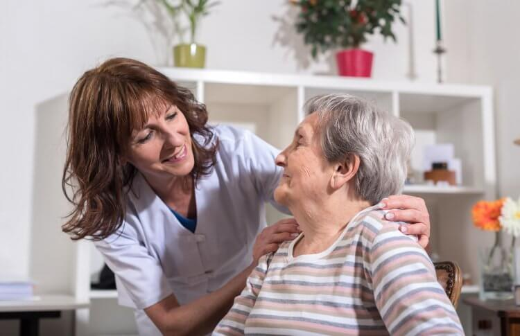 Nurse and Woman in long-term care