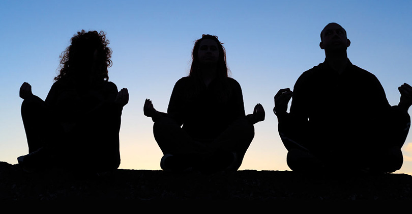 3 people meditating