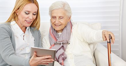Older and younger women using a tablet